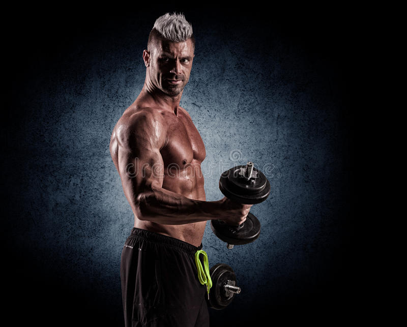 Fit muscular man exercising with dumbbell royalty free stock photos