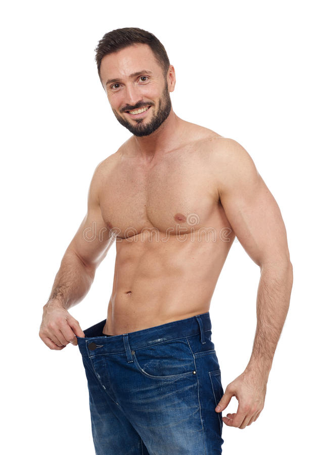 Fit muscular man. Muscular man with larger jeans stock photos