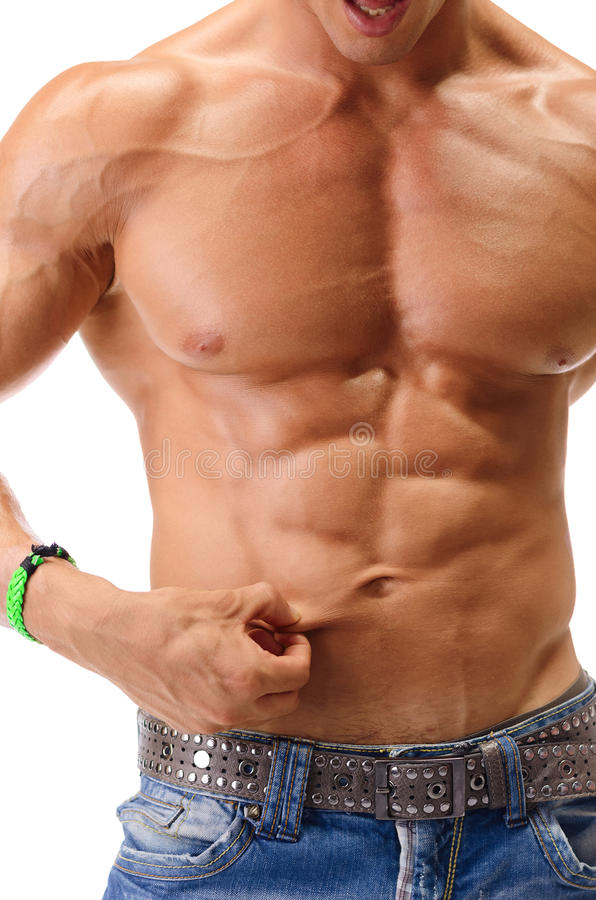 Fit muscular young man pinching his belly skin. Fit, athletic muscular young man pinching his stomach skin and showing abs royalty free stock photos