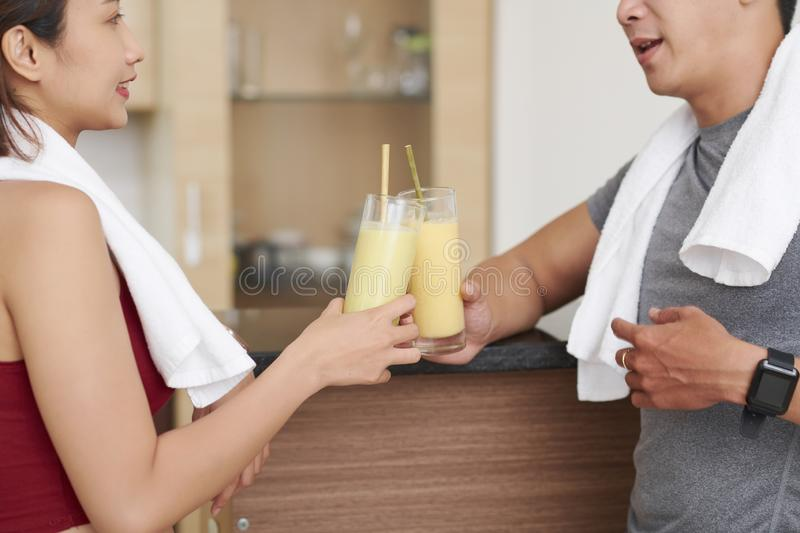 Fit people enjoying protein cocktails royalty free stock images