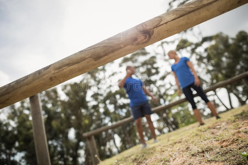 Fit people interacting with each other in boot camp stock images