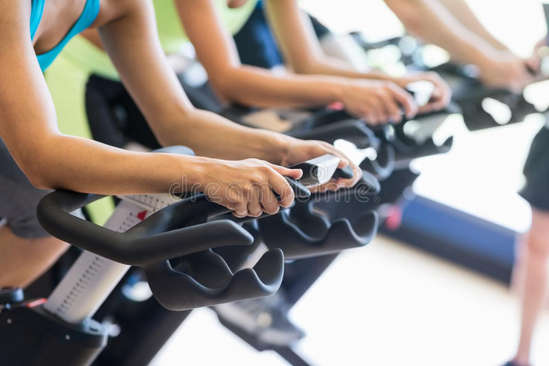 Fit people in a spin class royalty free stock photography