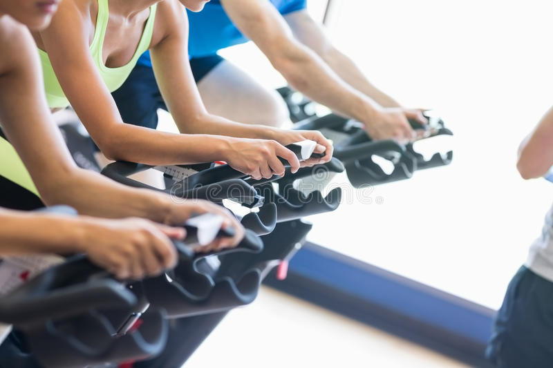 Fit people in a spin class stock images