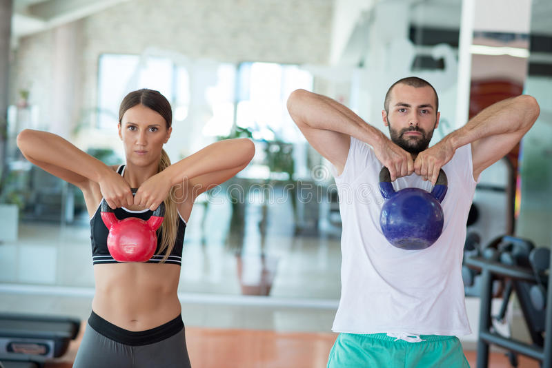 Fit people working out in fitness class at the gym royalty free stock photography