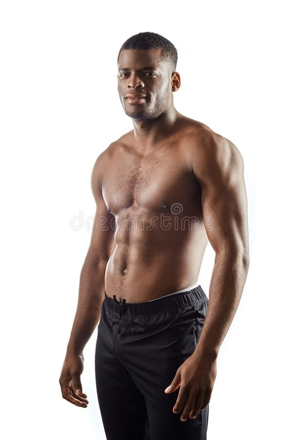 Fit pleasant athlete with perfect body posing to the camera royalty free stock photo