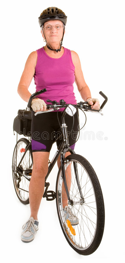 Fit Senior Woman Riding a Bicycle stock images