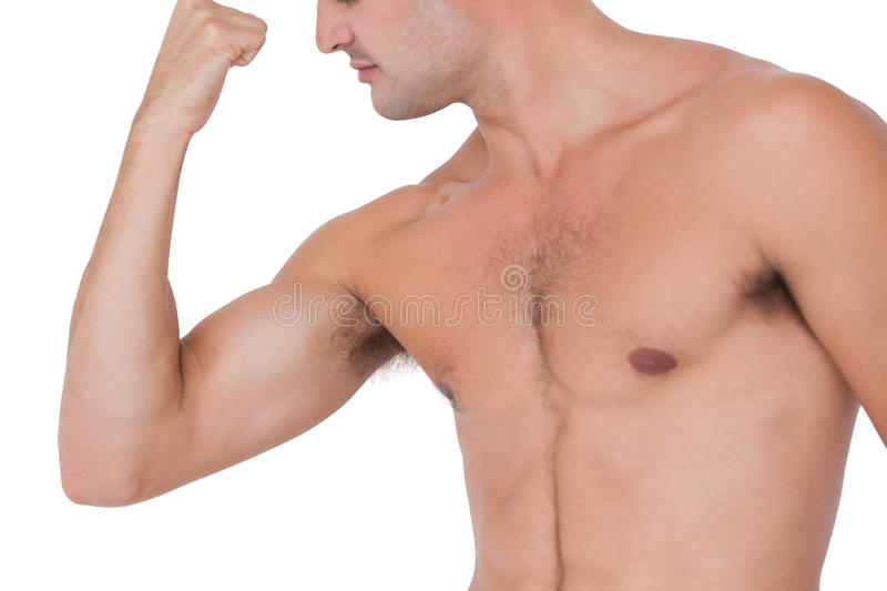 Fit shirtless man flexing his bicep. On white background stock images