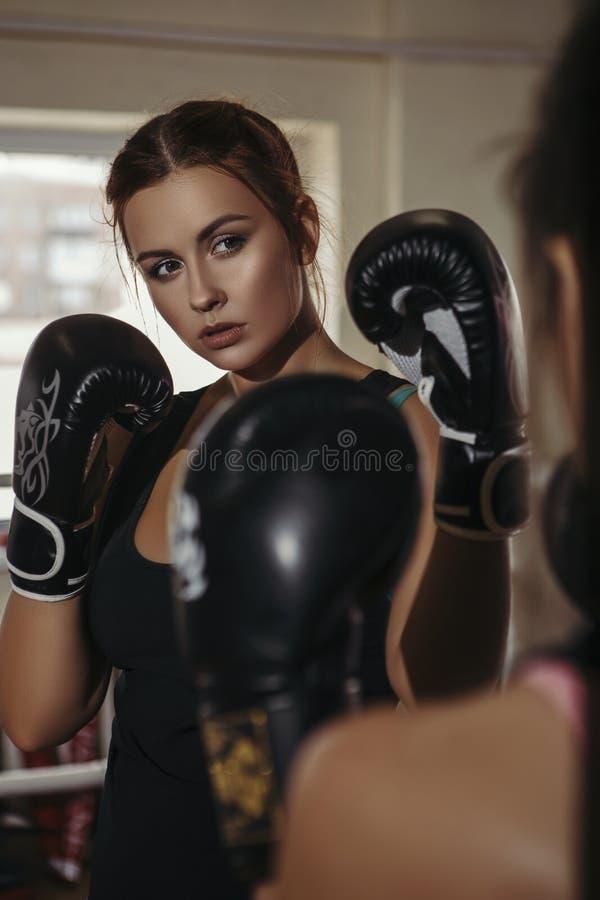 Fit slim young beautiful brunette women boxing in sportswear. Da. Rk dim light. Toned image stock images