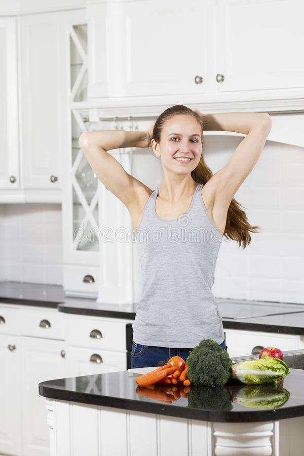 Fit and Smiling Woman with Healthy Food royalty free stock images