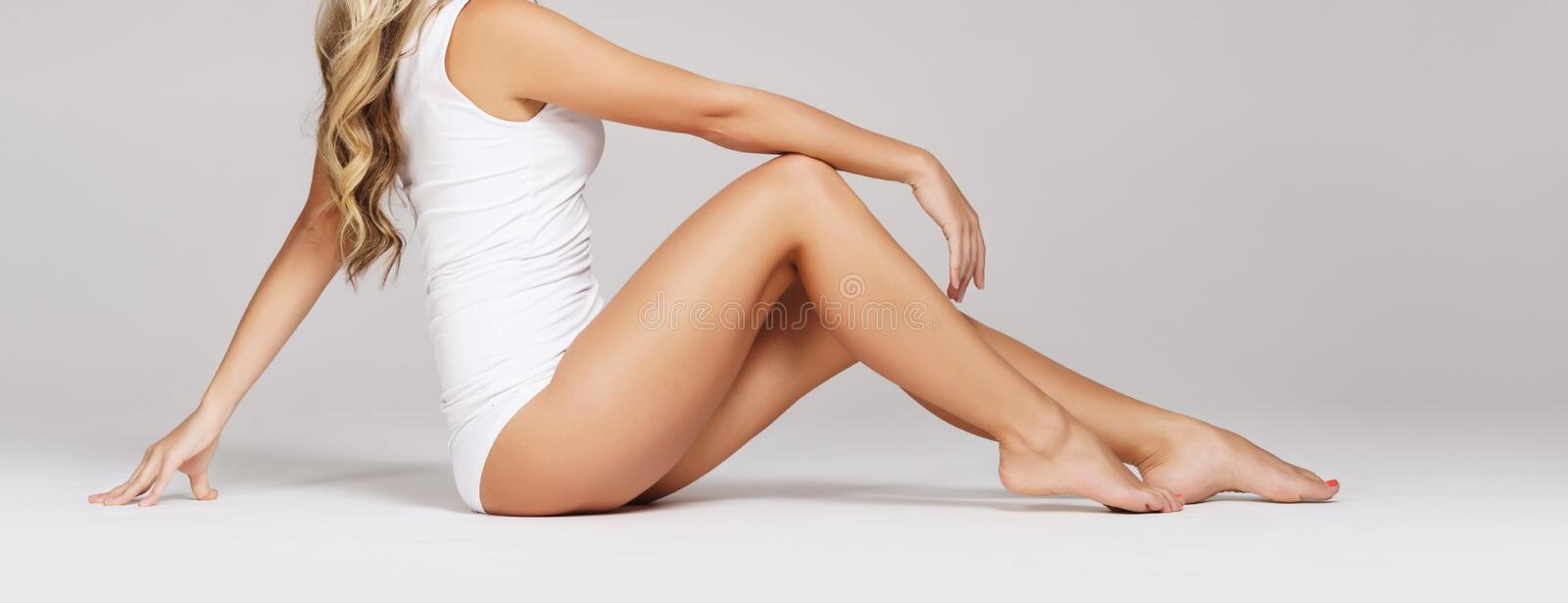 Fit and sporty beautiful woman with perfect shape. Girl in white royalty free stock photo
