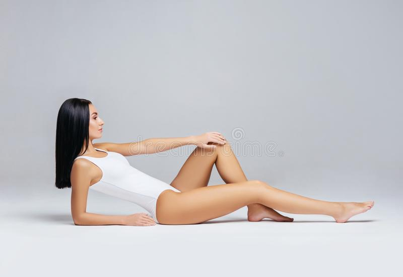 Fit and sporty girl in white swimsuit. Sport, fitness, diet, weight loss and healthcare concept. Fit and sporty girl in underwear. Beautiful and healthy woman royalty free stock image