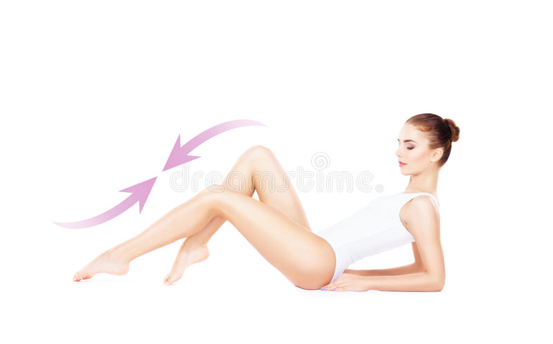 Beautiful fit girl posing on isolated background with drawing arrows. Health, sport, fitness, nutrition, epilation, cellulite and. Hair removal, liposuction royalty free stock photo