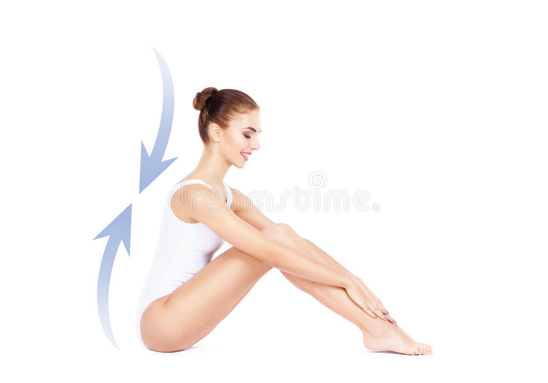 Beautiful, young and sporty girl with arrows isolated on white. Health, sport, fitness, nutrition, weight loss, diet, cellulite r stock photos
