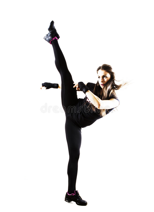 Fit woman doing a high kick stock image