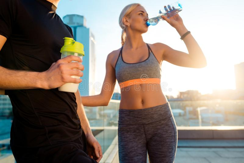 Fit woman is drinking water stock photos