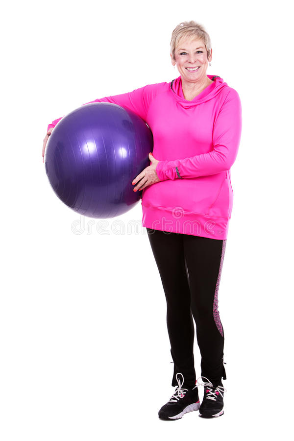 Fit woman with excercise ball. Caucasian middle aged woman on white background stock photo