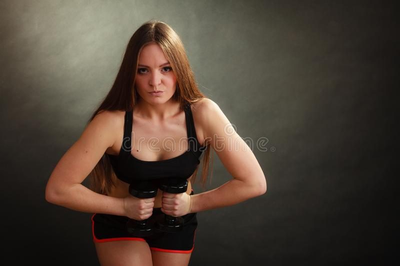 Fit woman exercising with dumbbells royalty free stock photos