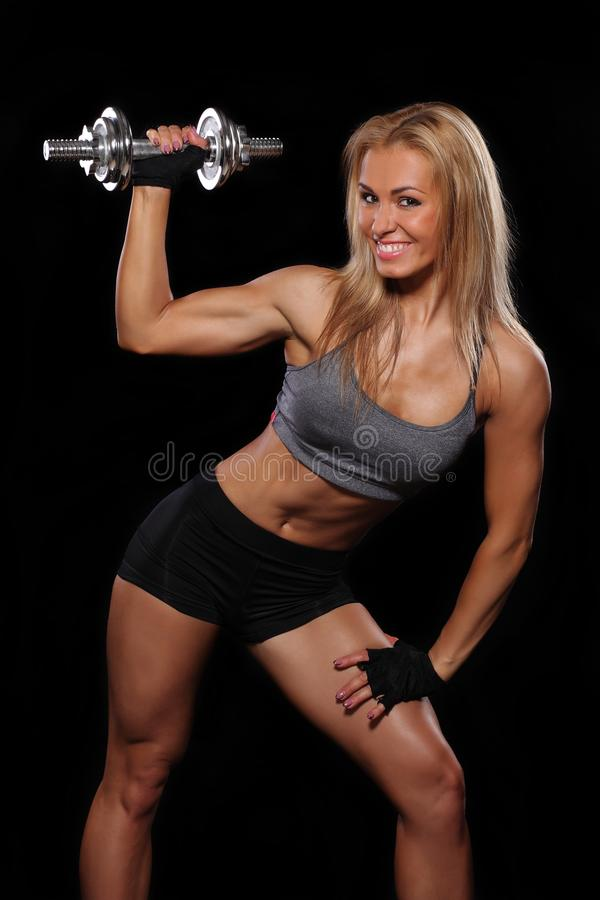 Fit woman exercising with dumbbells. stock photo
