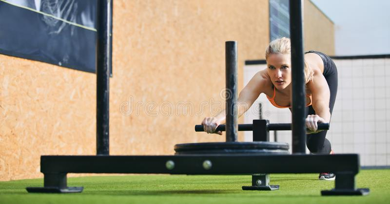 Fit woman exercising to stay stock image