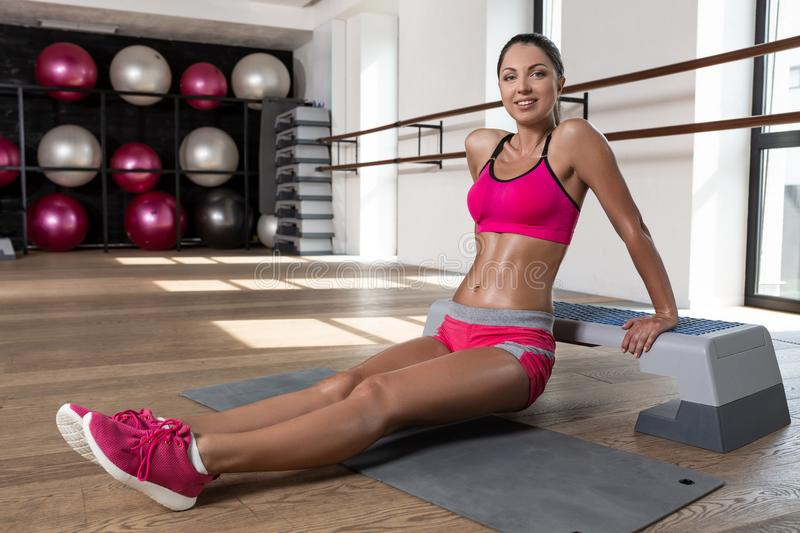 Fit woman exercising workout out arms exercise training triceps and biceps doing push ups. Program of training in the gym stock image