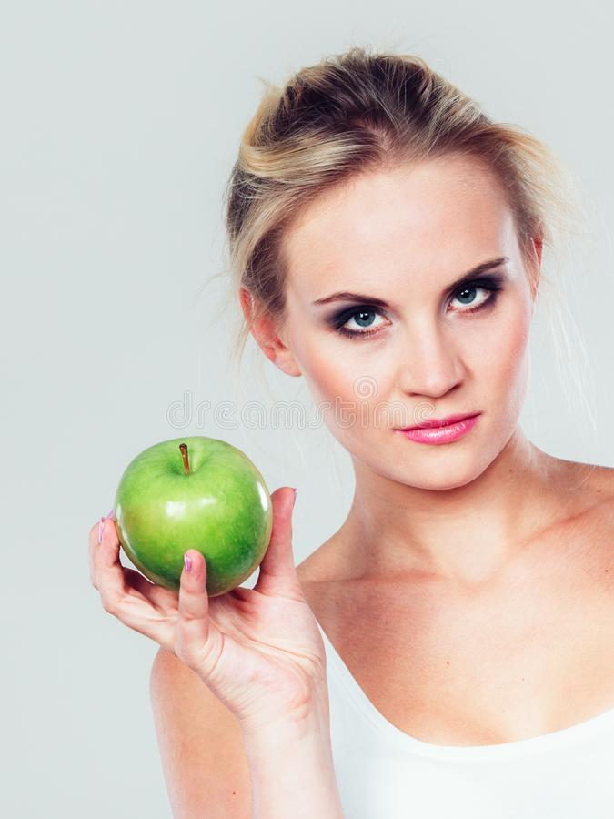 Fit woman holding apple fruit, dieting concept royalty free stock image