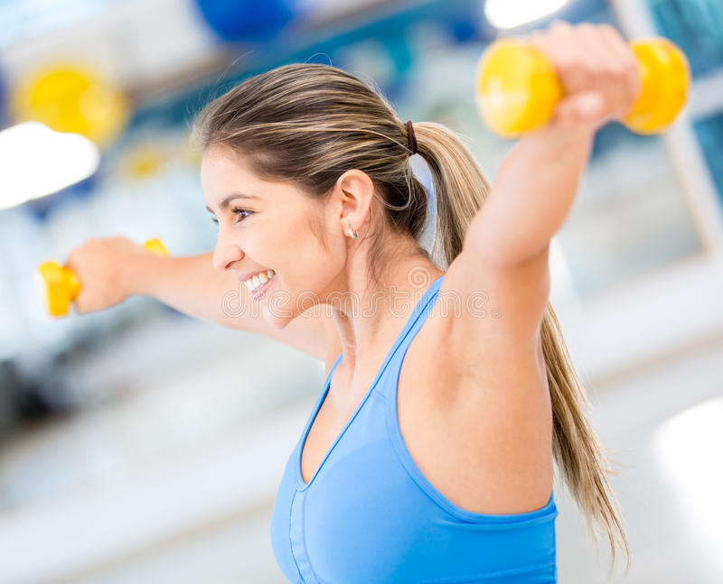 Download Fit woman lifting weights stock photo. Image of beauty - 27664316