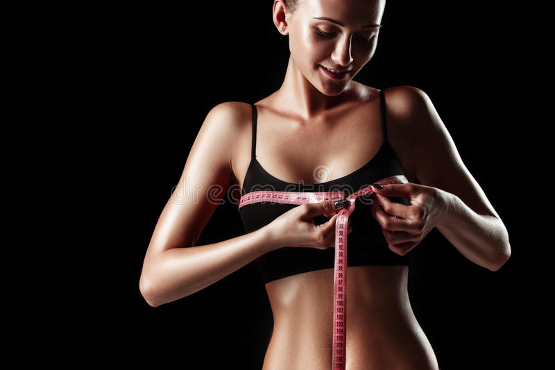 The fit woman measuring perfect shape of beautiful body. Healthy lifestyles concept stock photos