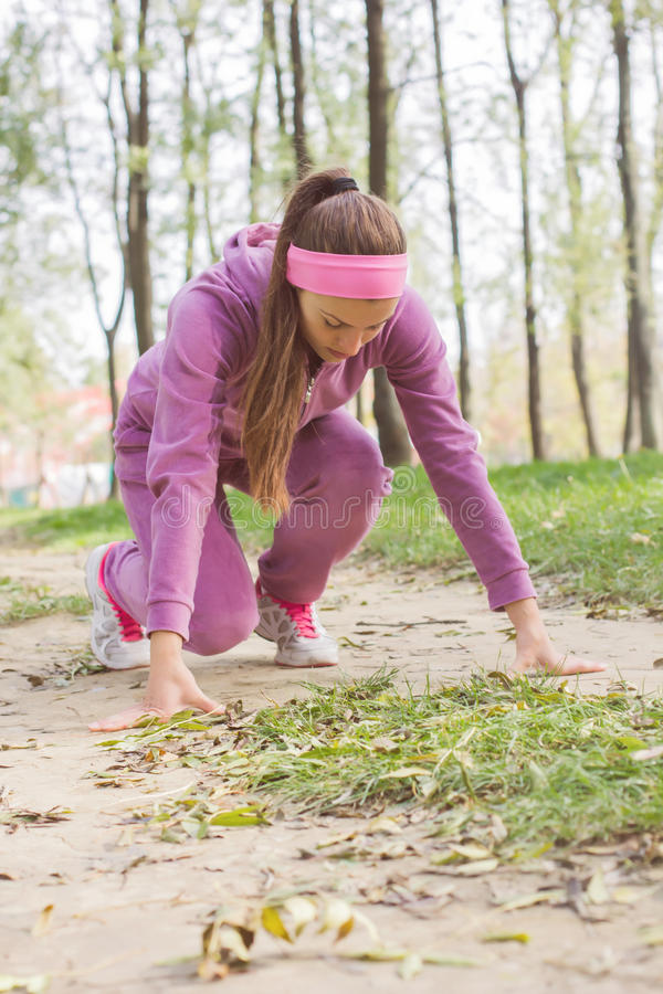 Fit Woman Practicing. Fitness Woman Running , female athlete, position ready for run, healthy lifestyle outdoor royalty free stock images