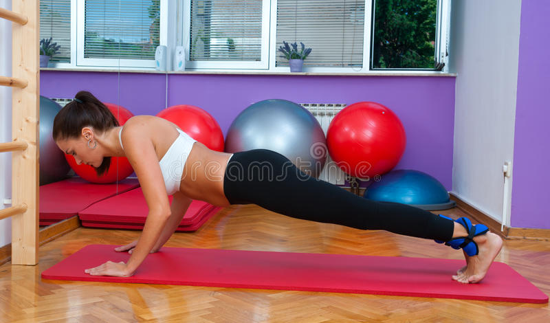 Fit Woman In Push Up Pose Royalty Free Stock Image