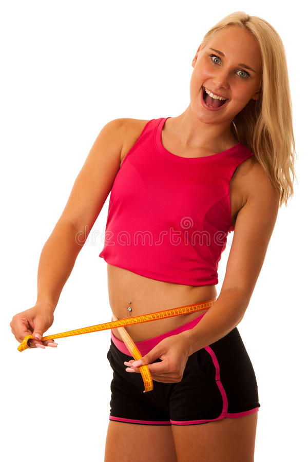 Fit woman with scale measuring her waste stock photography
