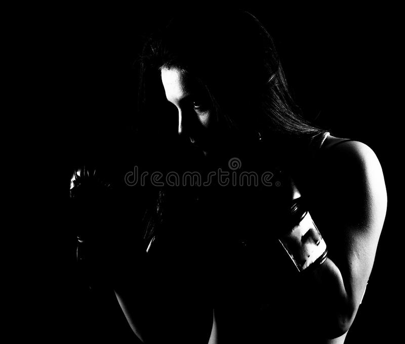 Fit woman shadow boxing stock image