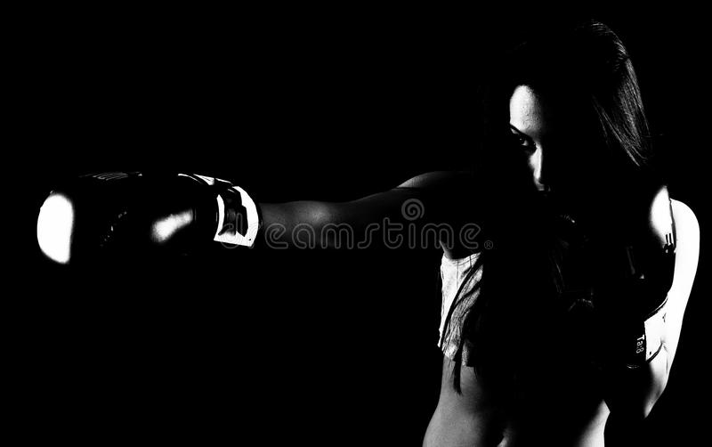 Fit woman shadow boxing. Strong fit woman shadow boxing stock image