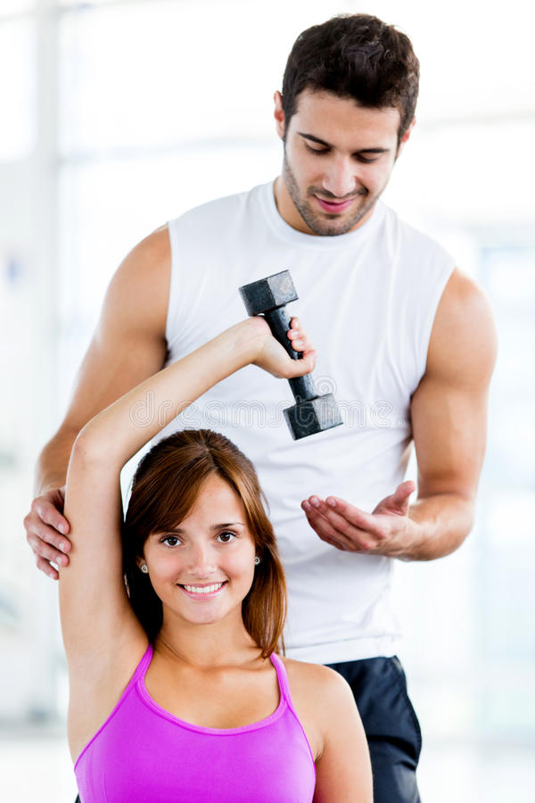 Download Fit woman with trainer stock image. Image of smiling - 25779901
