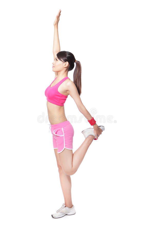 Fit woman warm up. Fit woman stretching her arm and leg to warm up before sporting isolated over white background, model is a asian girl stock images