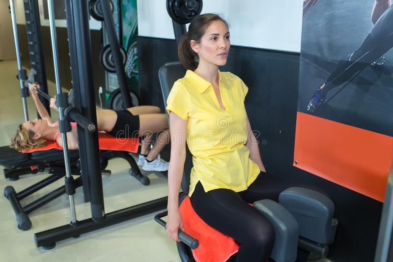 Fit woman training legs at gym. Fit women training her legs at a gym stock images
