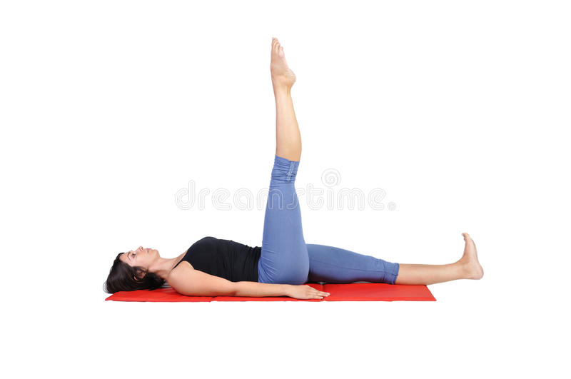 Fit young female pilates instructor. Showing different exercises on a white background stock photos