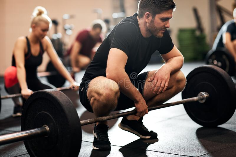 Fit young man ready for a gym weightlifting class royalty free stock image