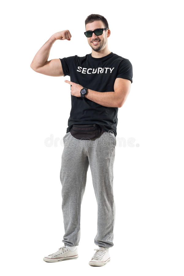 Fit young man in sportswear with fanny pack showing flexing bicep arm muscle stock image