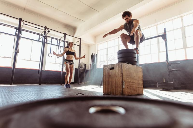 Couple during intense workout session at health club stock photos