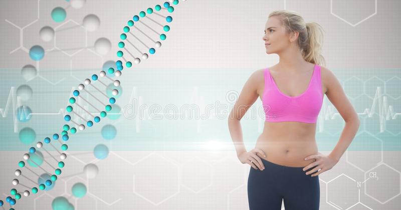 Fit young woman with hands on hips looking at DNA structure stock images
