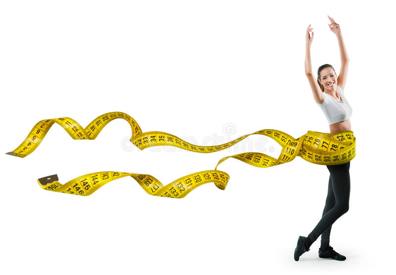 Fit young woman with a large measuring tape stock photo