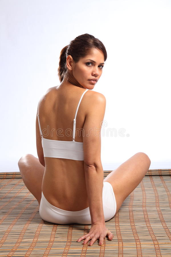Fit Young Woman Looking Back Over Her Shoulder Stock Images