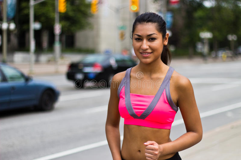 Fit young woman running stock photography