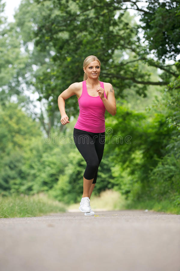 Download Fit Young Woman Running In The Park Stock Photo - Image of nature, happiness: 32648750