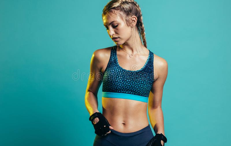Fit young woman in sportswear royalty free stock photography