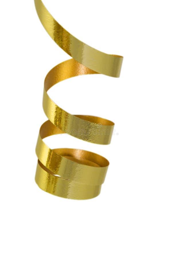 Fita curly do ouro foto de stock