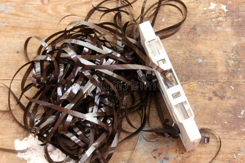 Fita da cassete áudio com fita tangled fotografia de stock royalty free