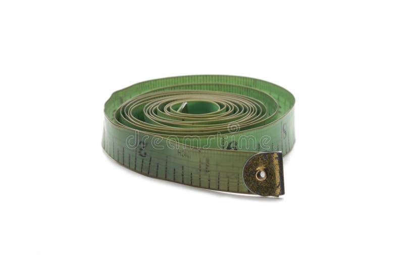 Fita de medição velha e usada verde do alfaiate ilustração stock