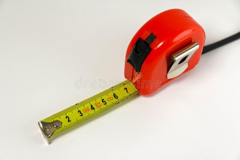 Fita de medição vermelha e amarela imagens de stock