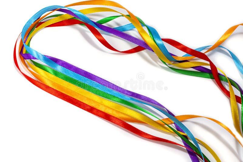 Fita do arco-íris de LGBT isolada no fundo amarelo, espaço da cópia, vista superior fotos de stock royalty free